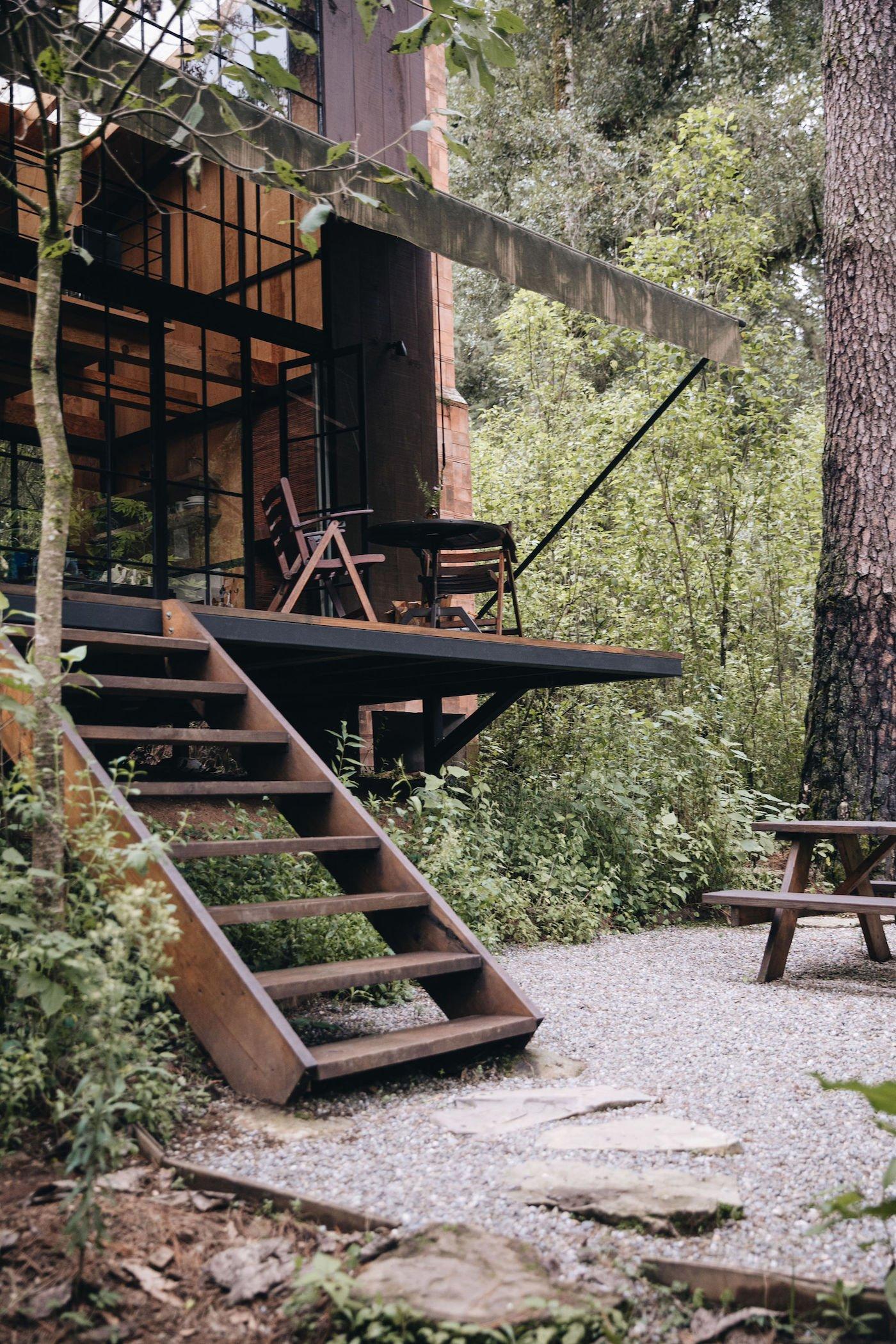 Wooden steps up to wooden verandah