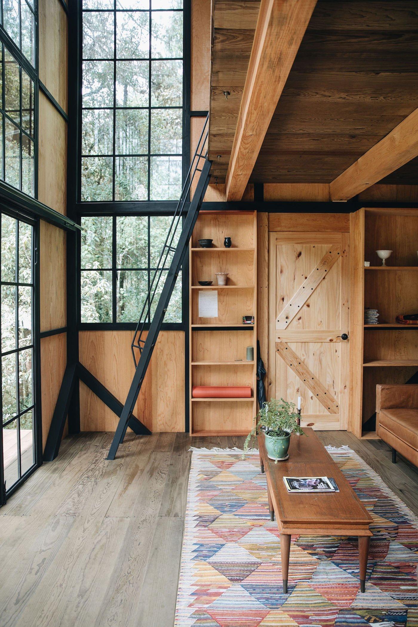 Large windows and timber walls timber flooring