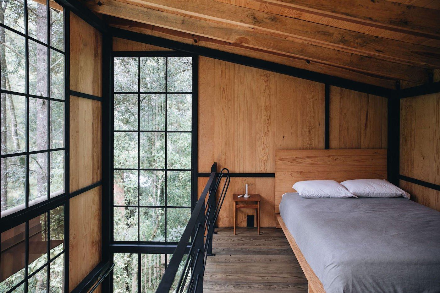 Loft bedroom in off-grid timber cabin