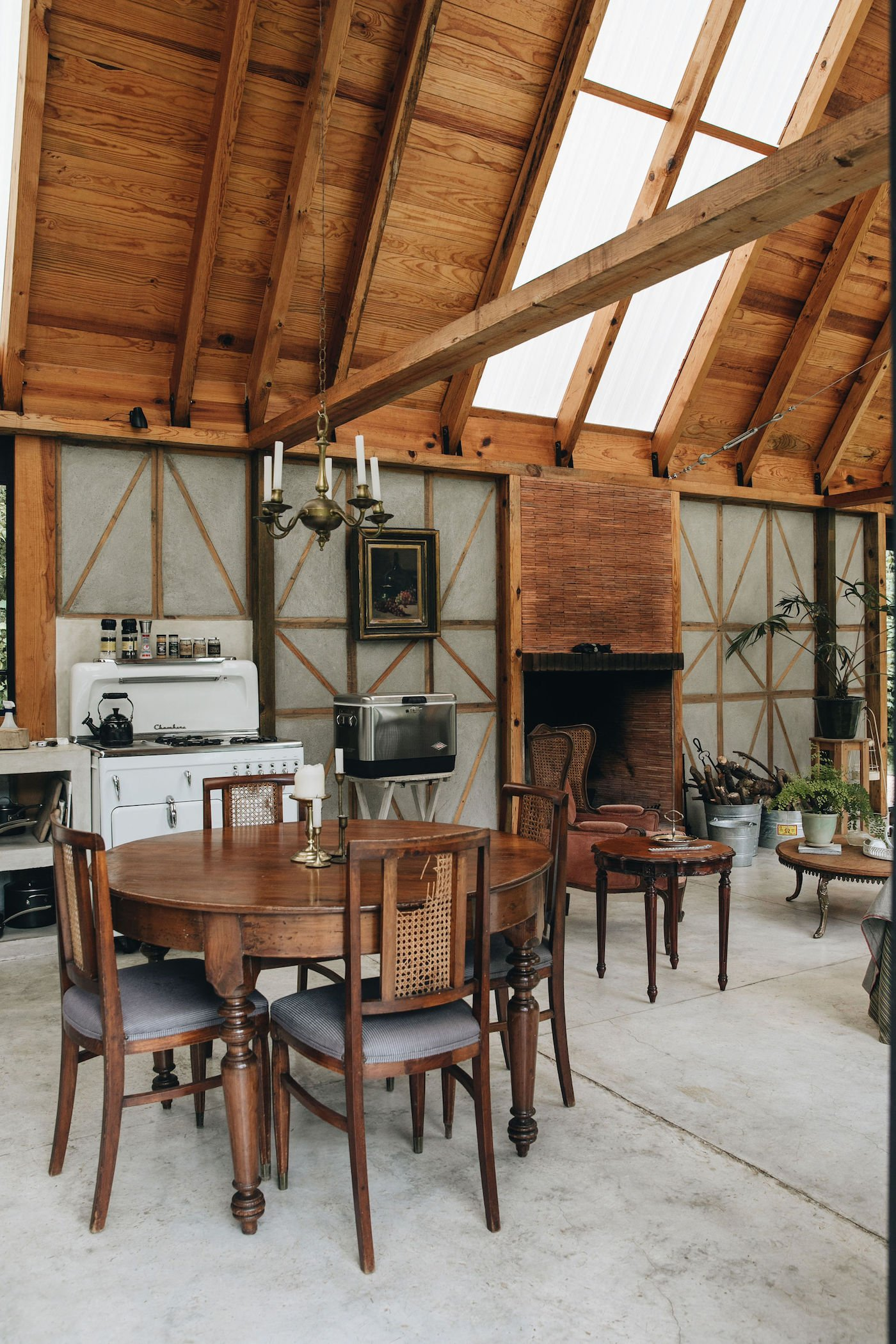 Dining and lounge room in off-grid timber cabin