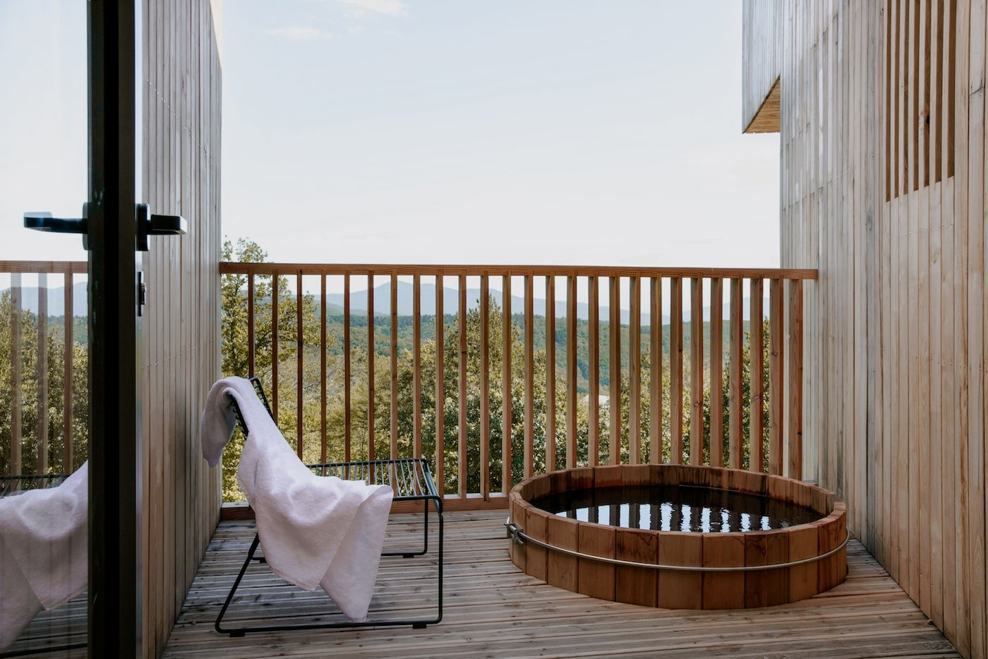 Timber hot tub on hotel room deck