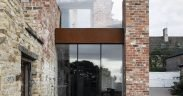 New glazed and corten steel insertion into adaptive reuse family home