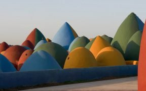 Colourful rammed earth dome village