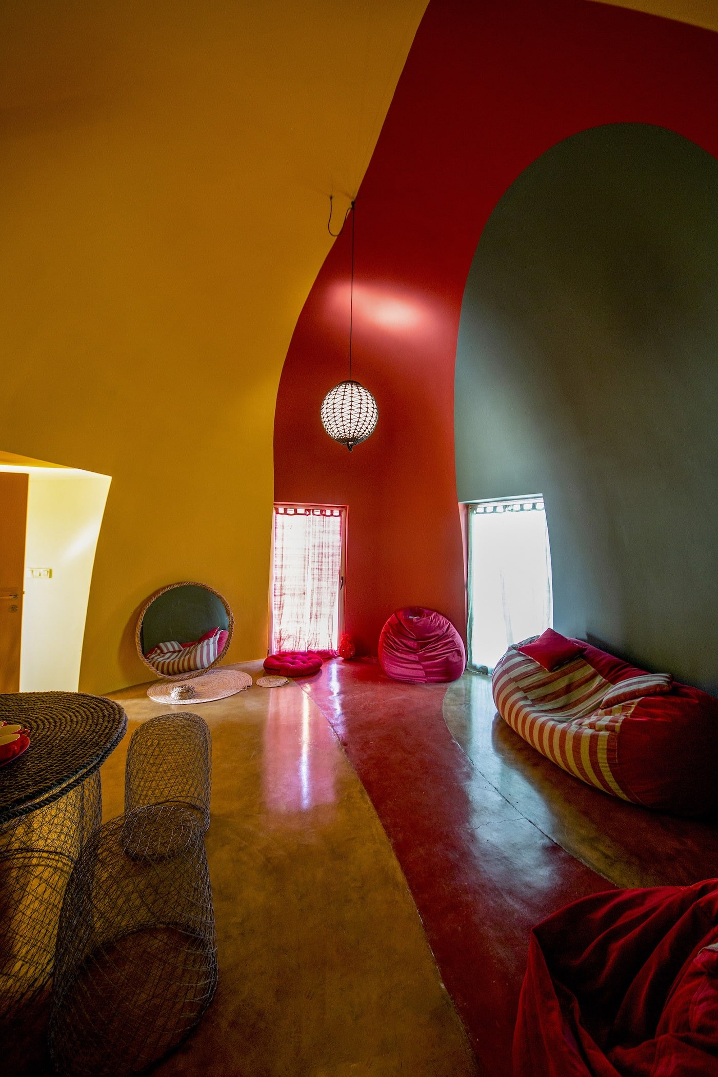 Yellow and red loungeroom in domed house