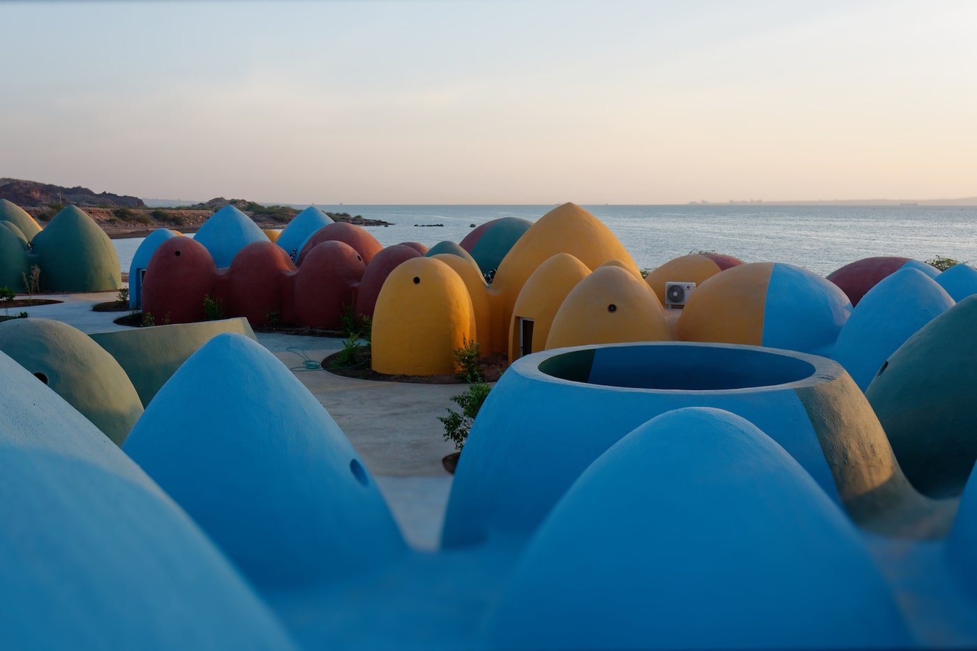 Colourful rammed earth domes