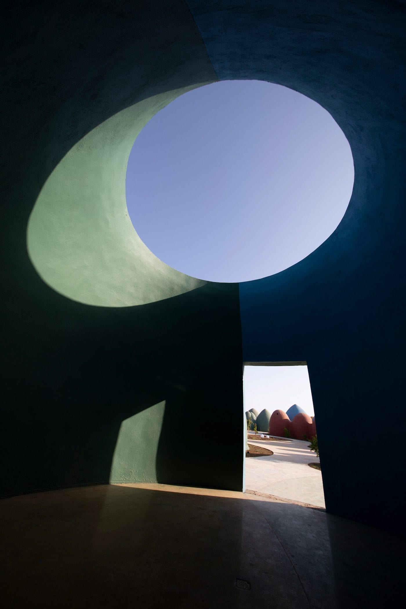 Shadows on round window in rammed earth dome