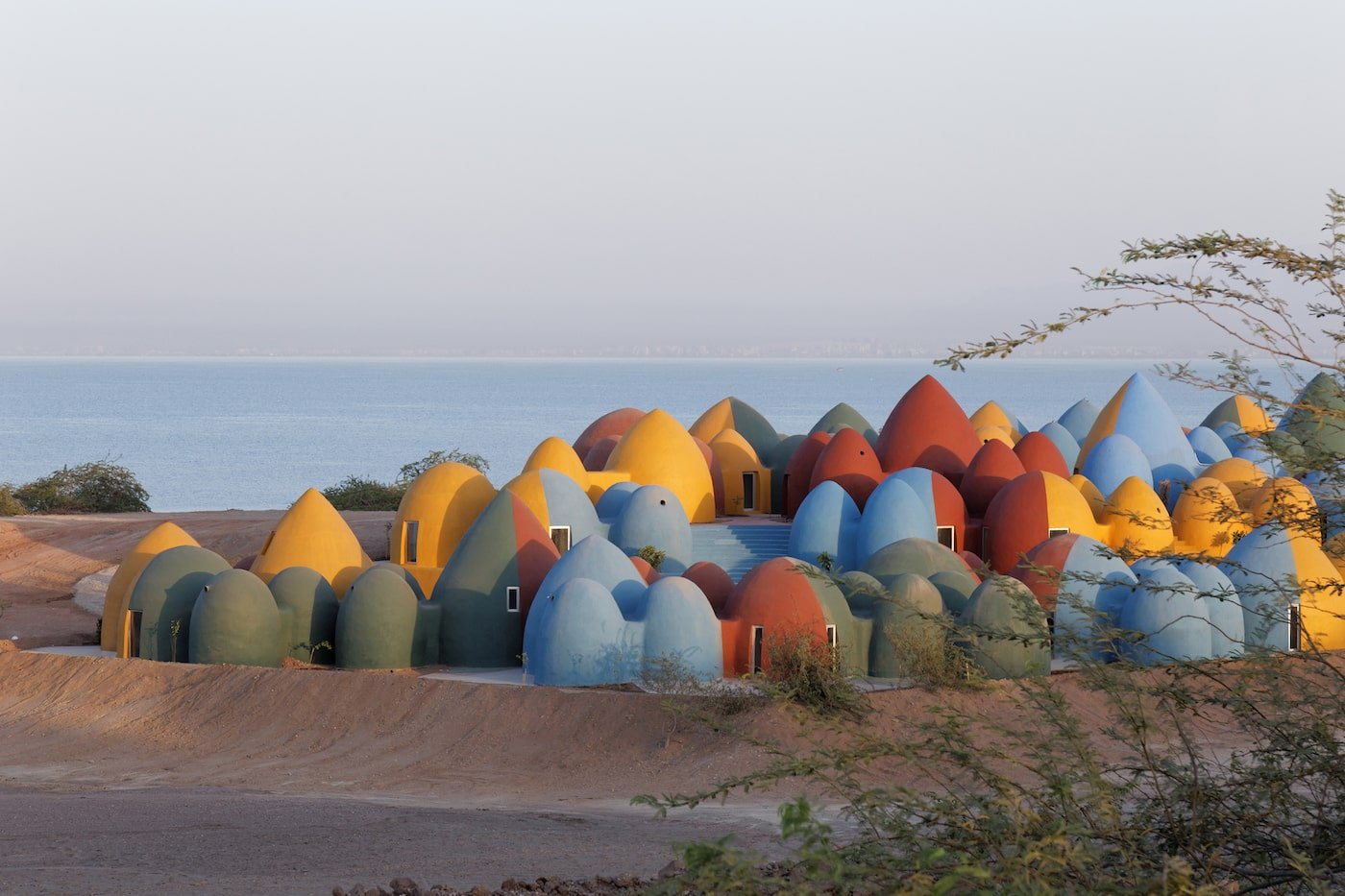 Rammed earth dome village