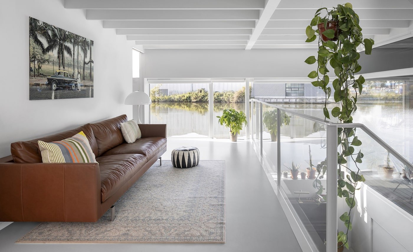 Lounge room with water views in floating home