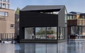 Floating home with black timber cladding