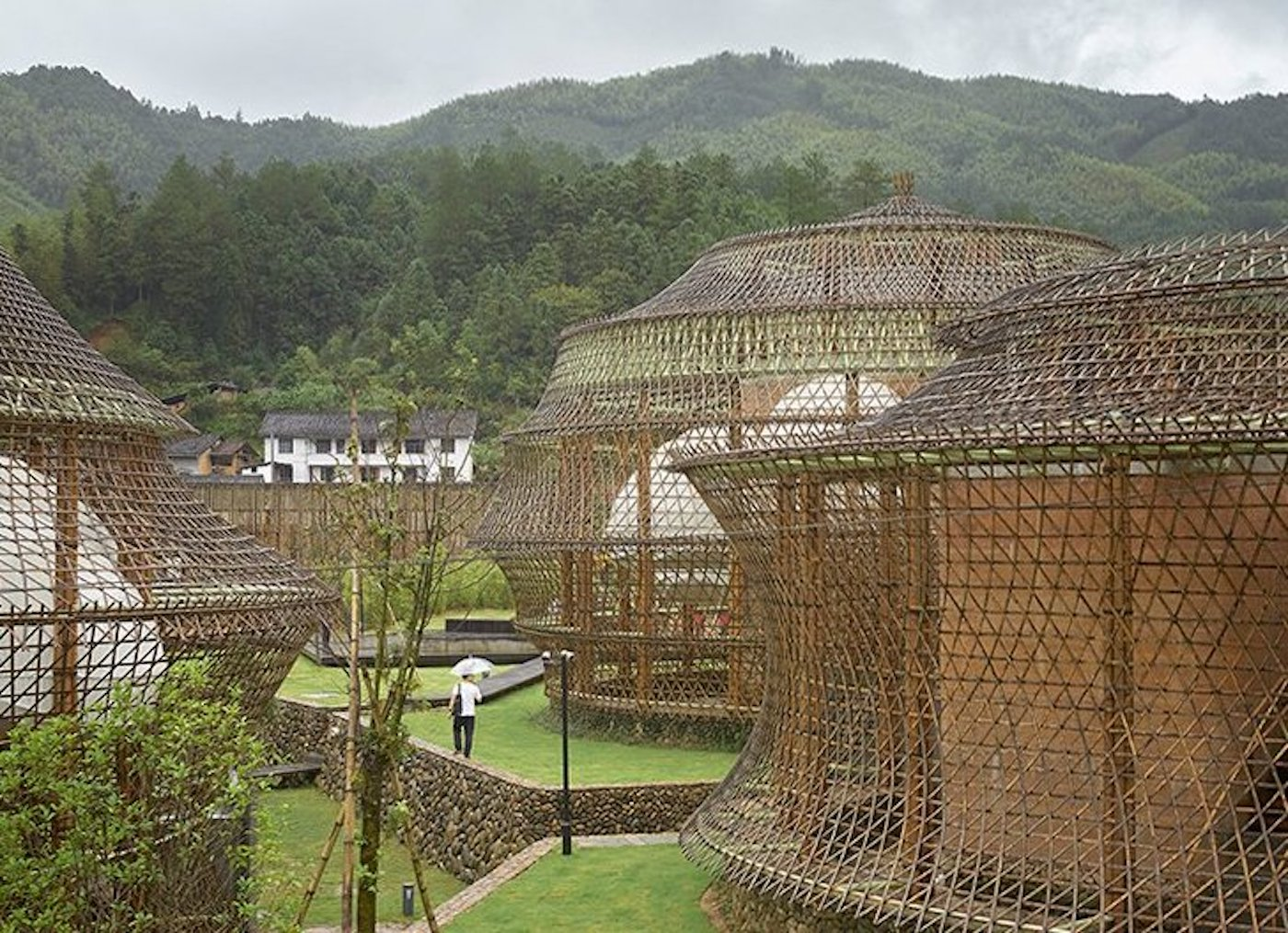 View of all three bamboo and rammed earth hostels