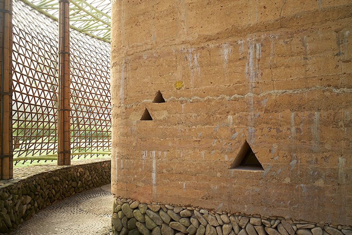 Close up of rammed earth and stone wall