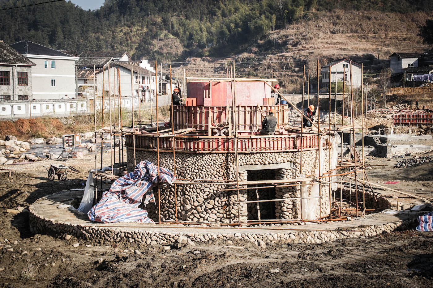 Construction of bamboo, rammed earth & stone building