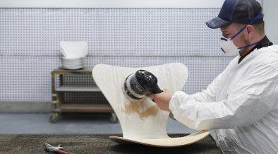 Man restoring a Arne Jacobsen Series 7 chair