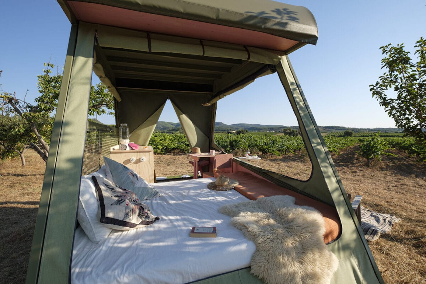 Queen size bed in off-grid camper with solar and green roof