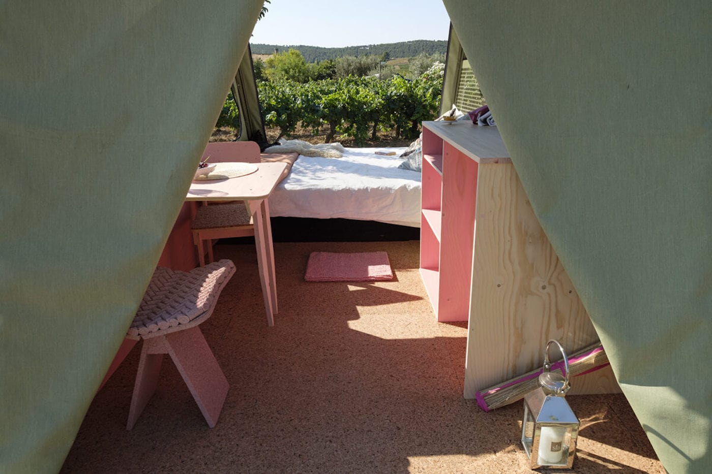 Looking inside off-grid EV with dining table, desk and bed