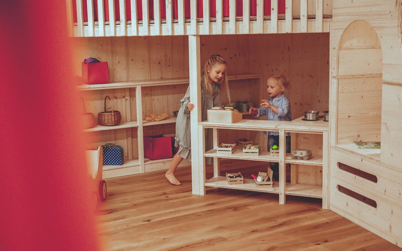 Kids playing with toys in sustainable childcare centre