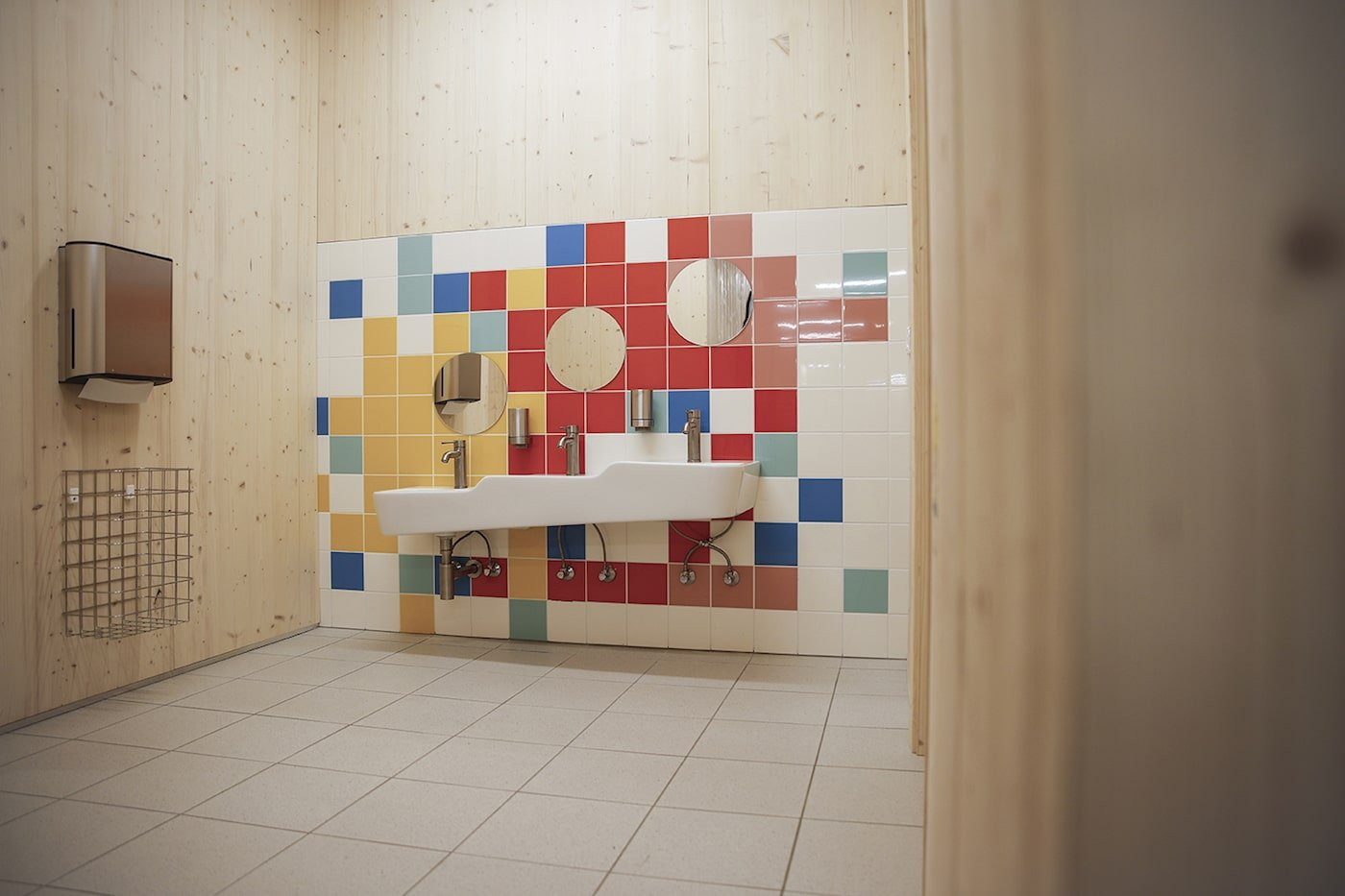 Colourful wall tiles in kids bathroom at Moar Gut childcare centre