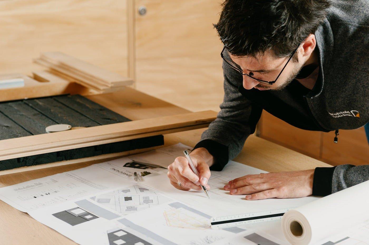 Man sitting at desk sketching