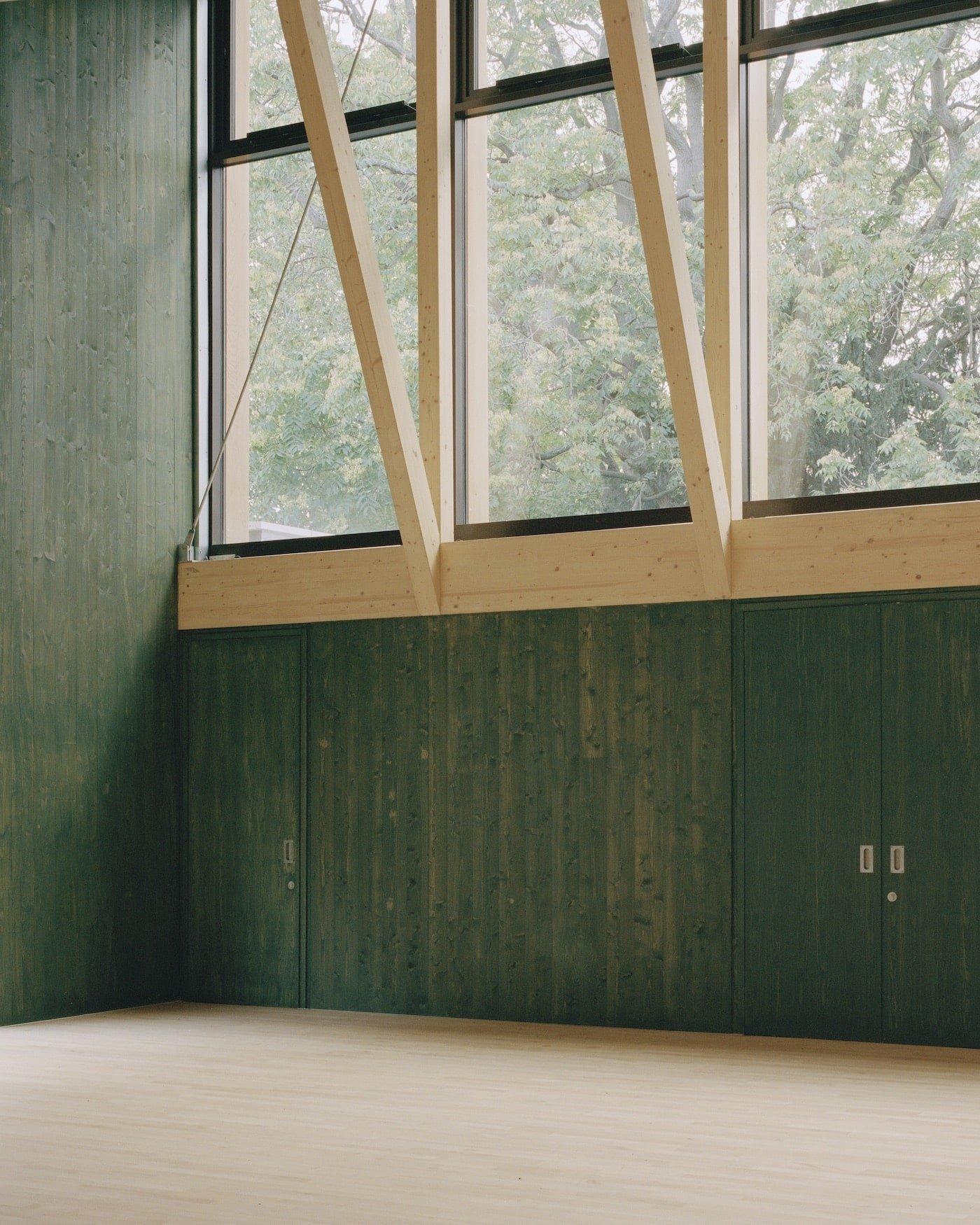 Cross laminated timber painted green walls