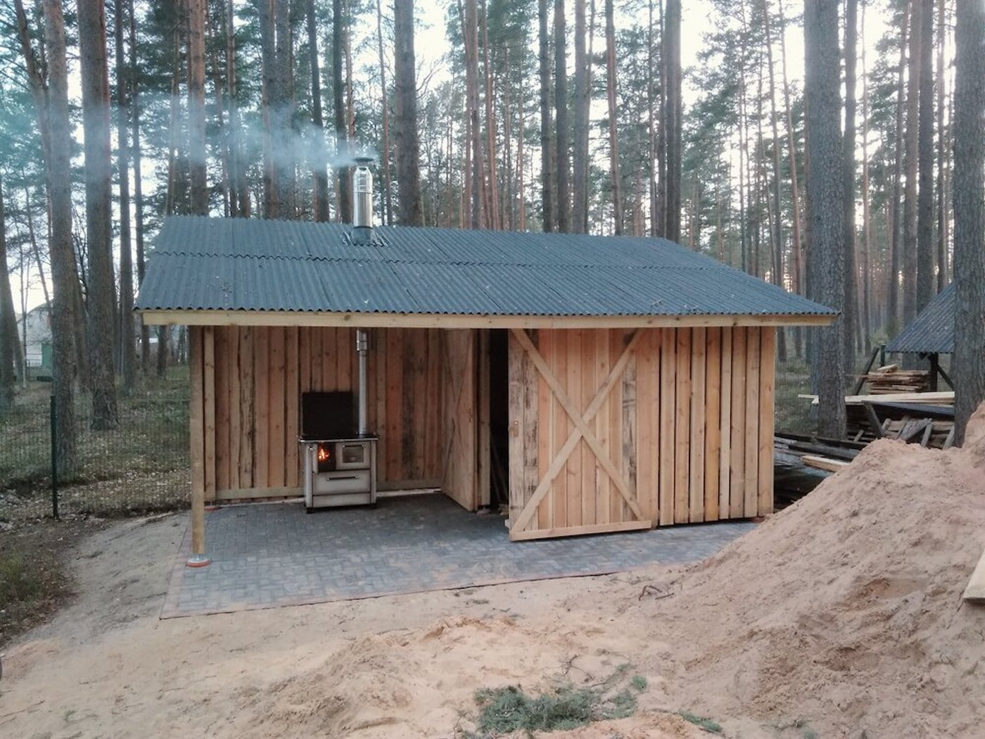 Timber shed with smoking chimney