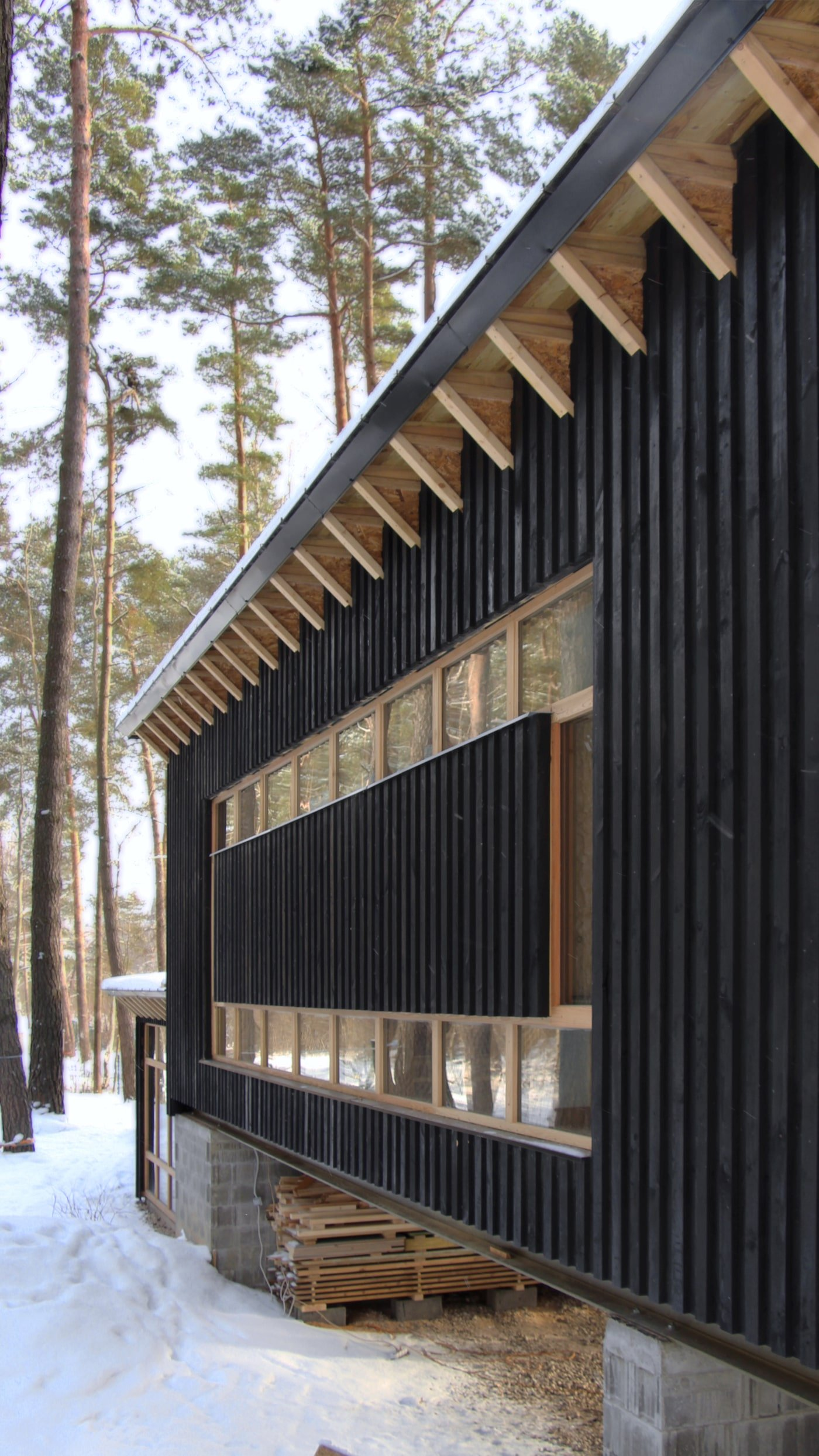 Side view of black timber clad facade