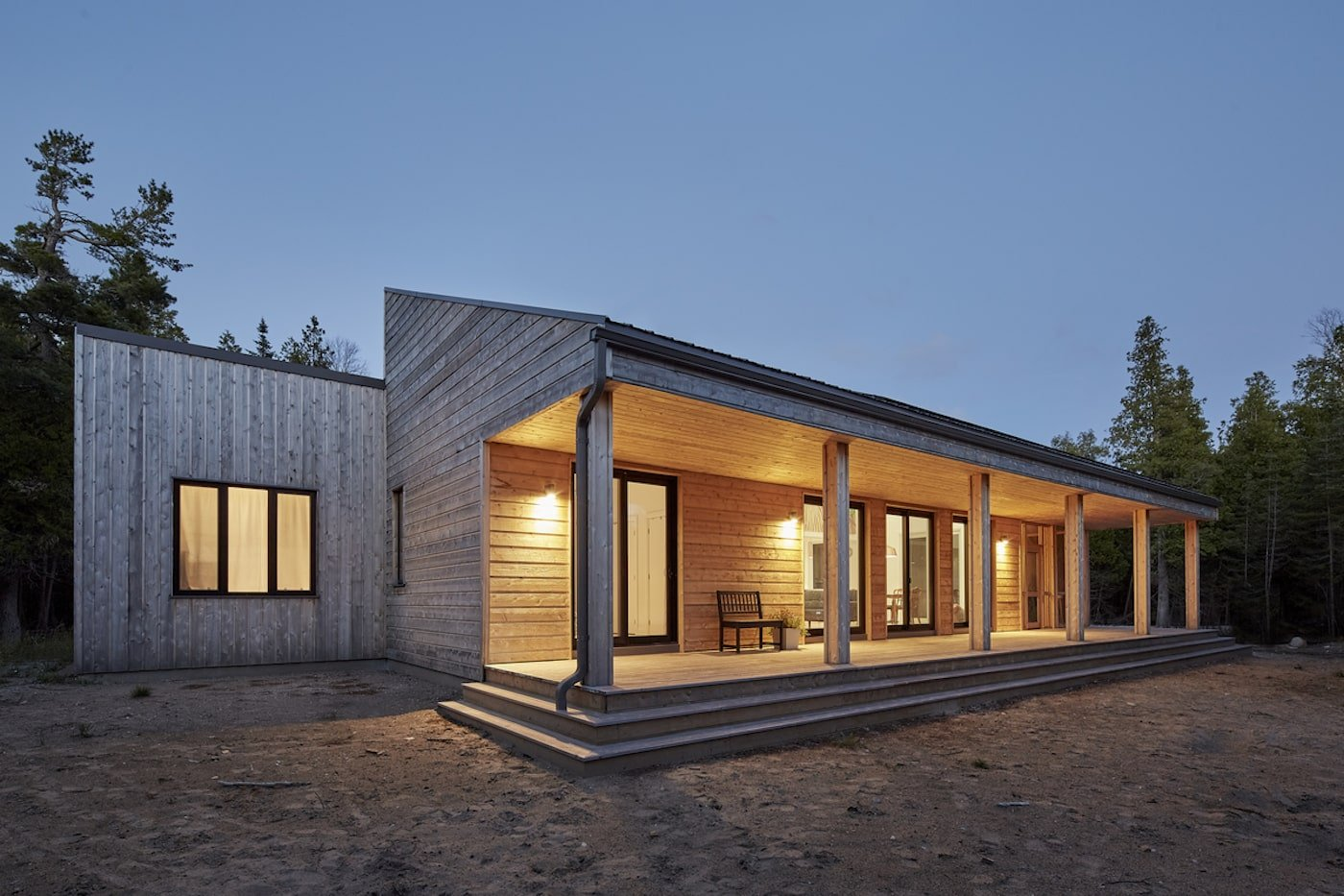 Exterior of off-grid island home at dusk