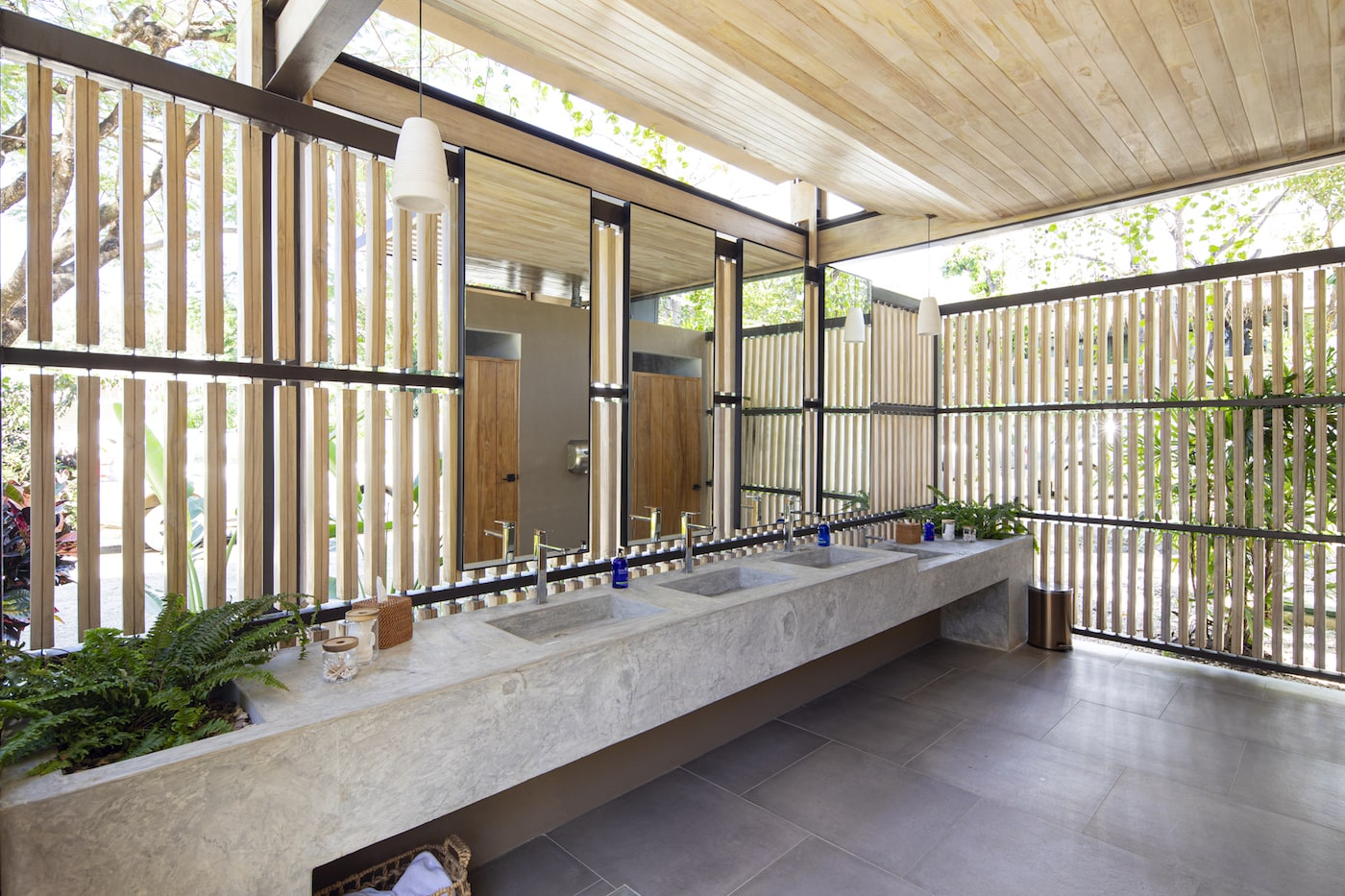 Bathroom with timber privacy screens and timber ceiling