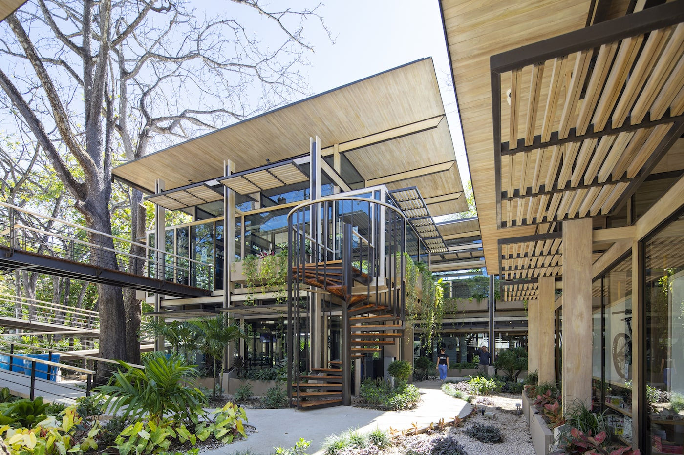 Timber clad building with covered walkways