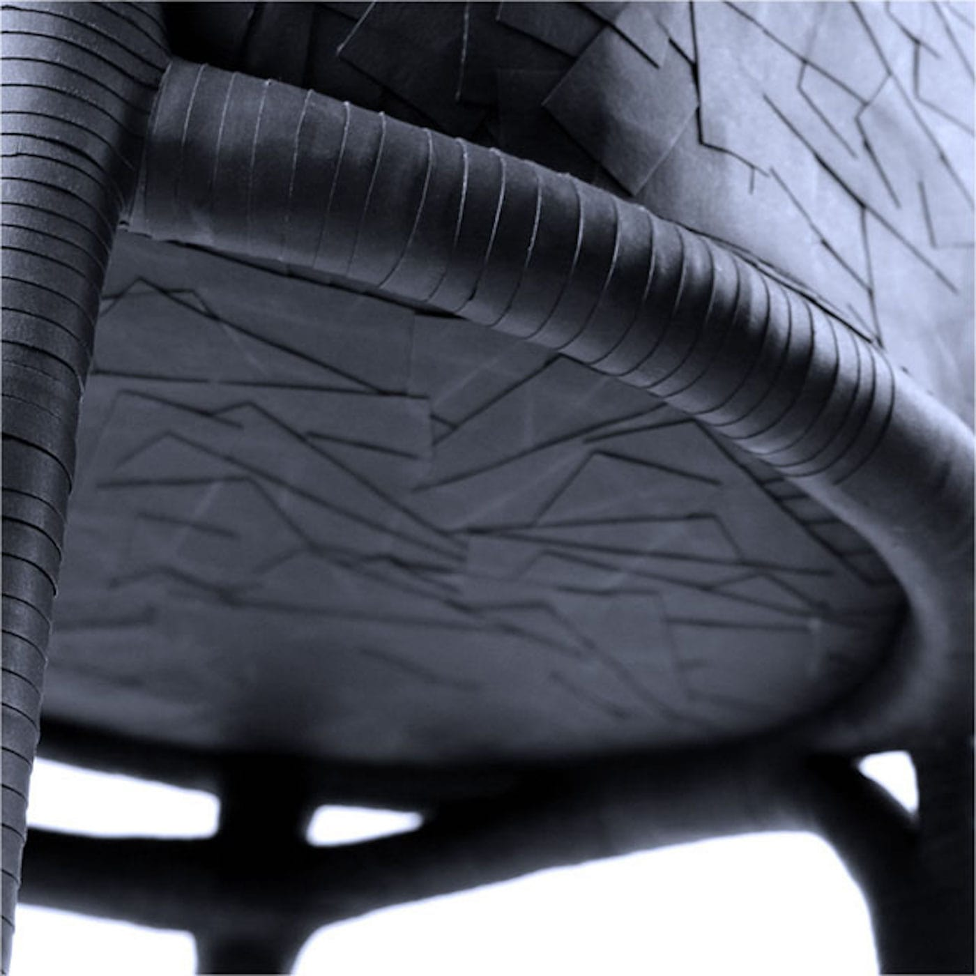 Close up of chair made from black paper