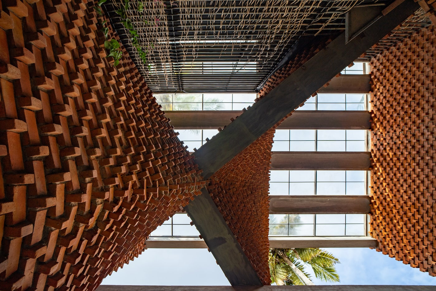 Looking up curved brickwork of Pirouette House