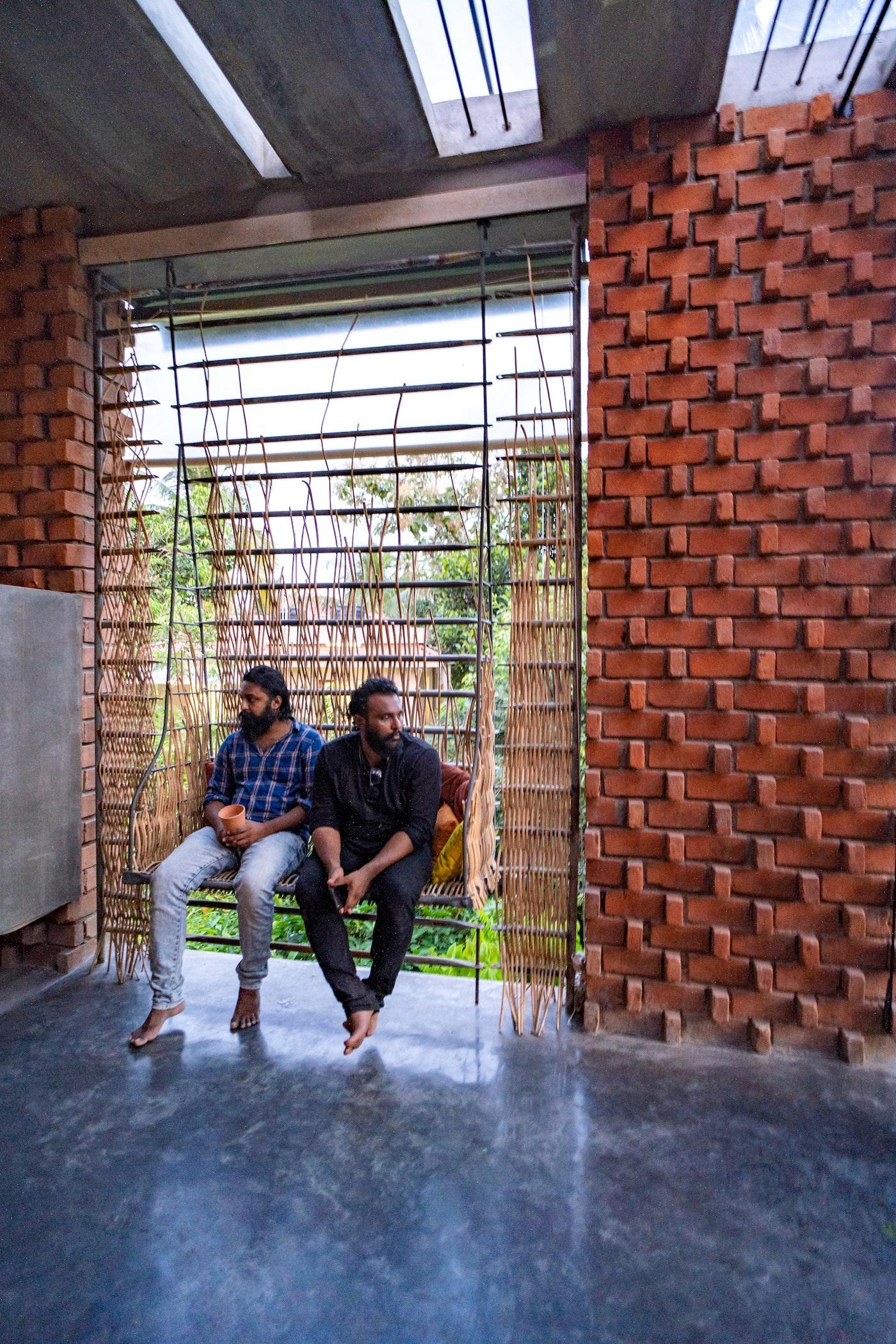 Man sitting on metal and bamboo window seat
