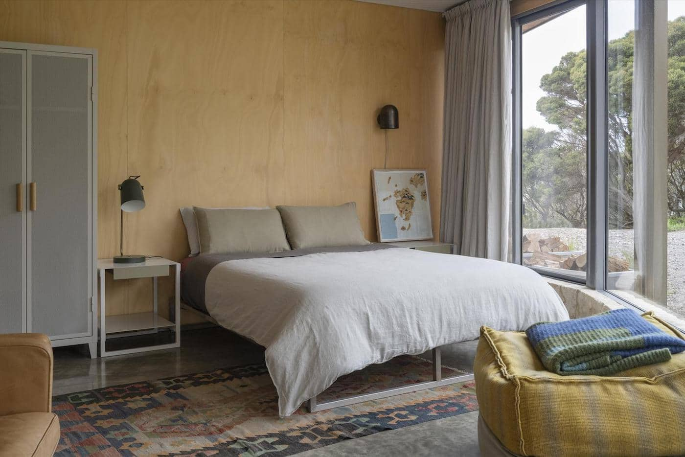 Timber wall and bed with white doona cover