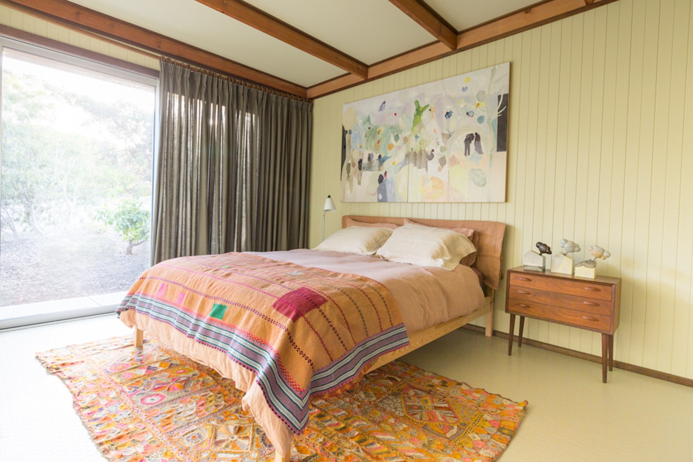 Bedroom with Weft Textiles bedlinen and timber lined wall
