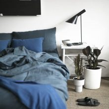 100% organic blue doona cover on timber bed