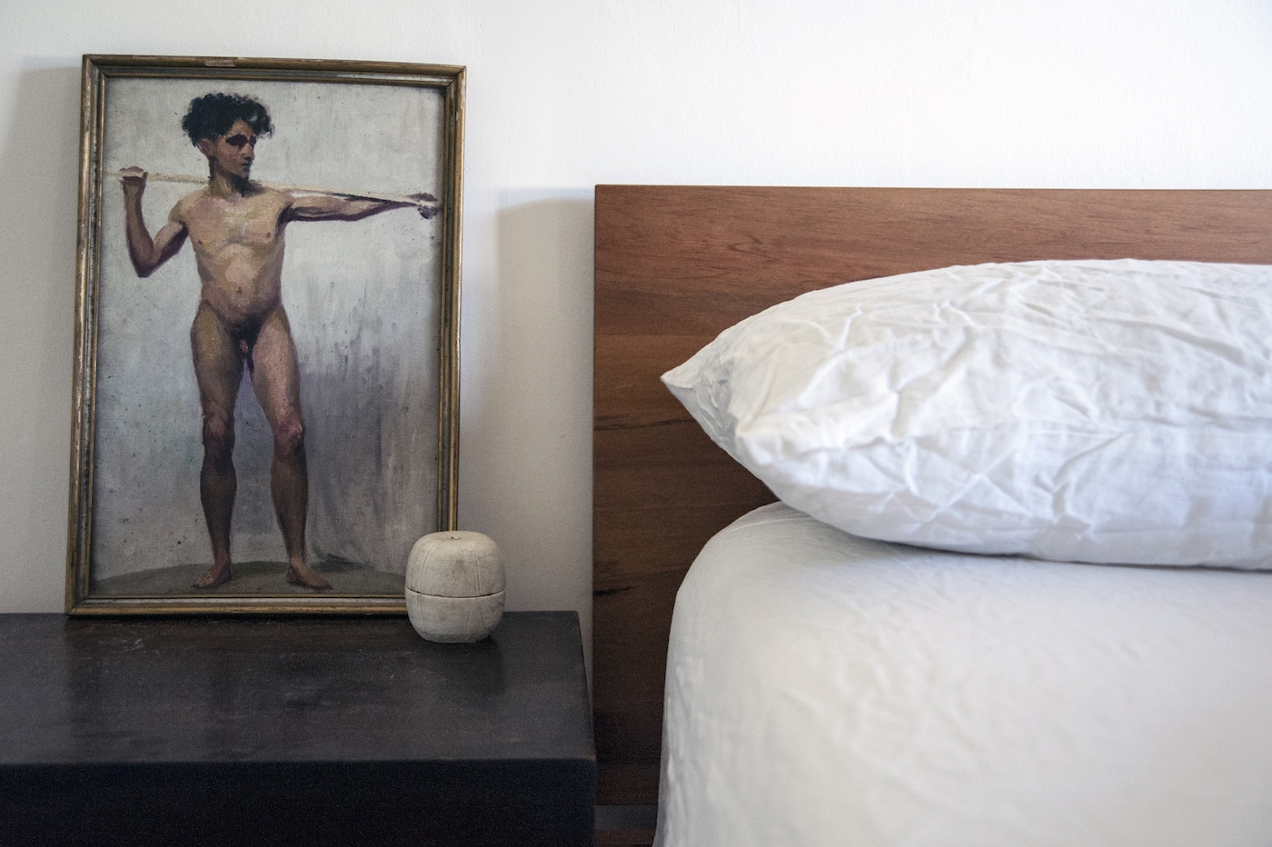 Timber bed made with white Weft Textiles pillow and doona cover