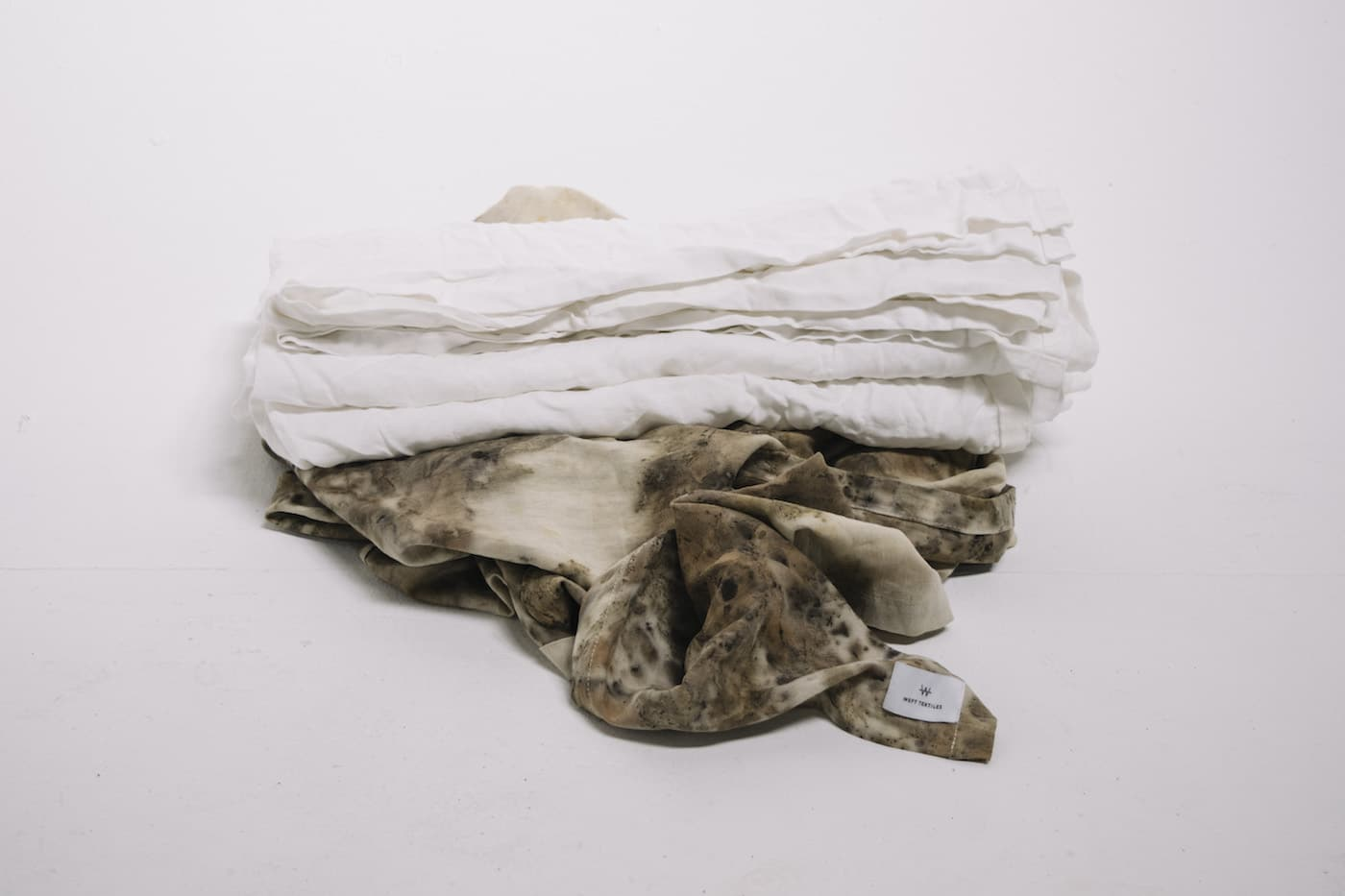 Weft Textiles white and sage green throw rugs