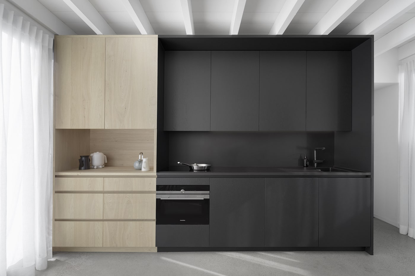 Close up of black and blond timber kitchen joinery