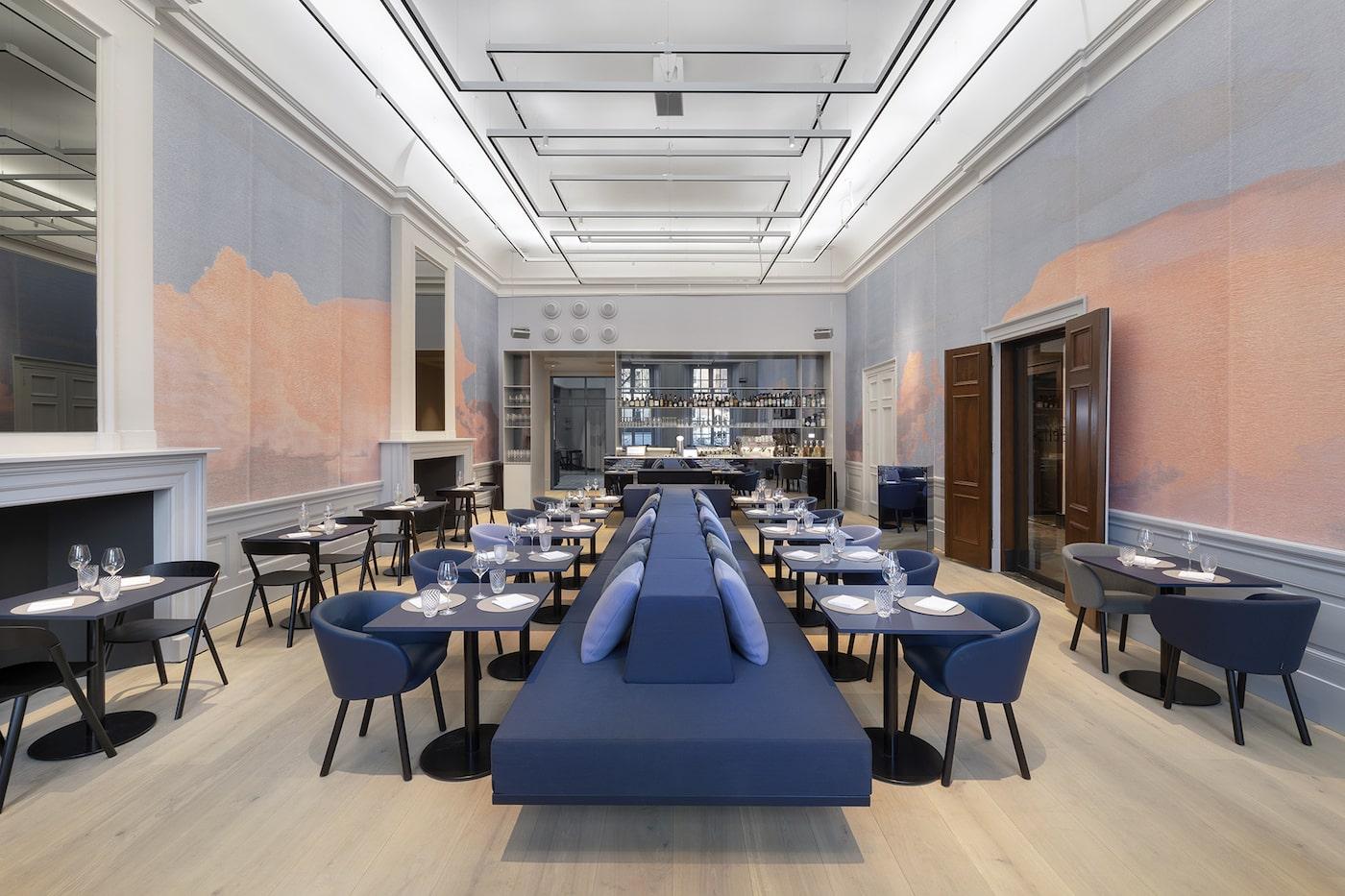 Restaurant with blue seating in Felix Meritis