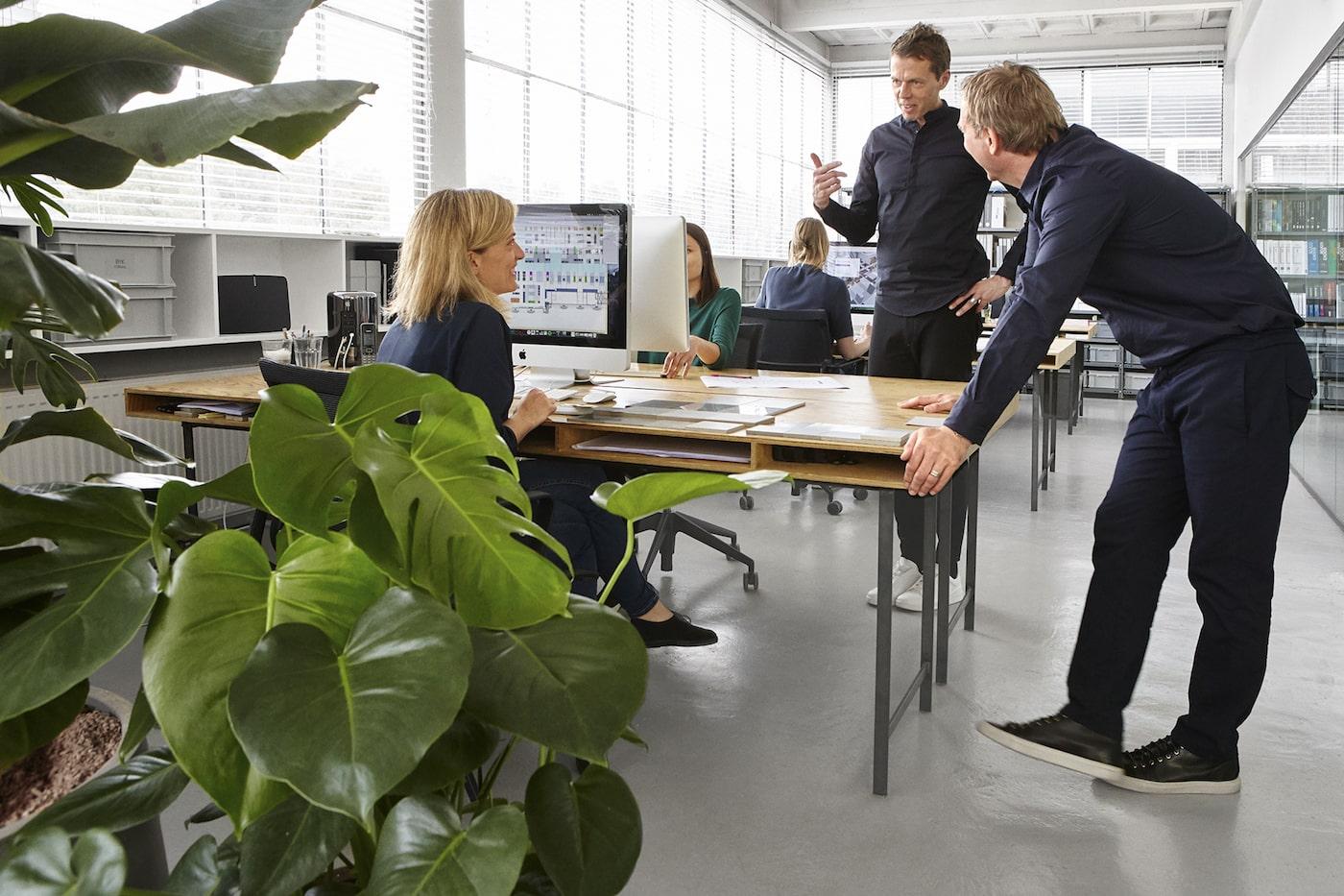 i29 design studio with team talking around desk