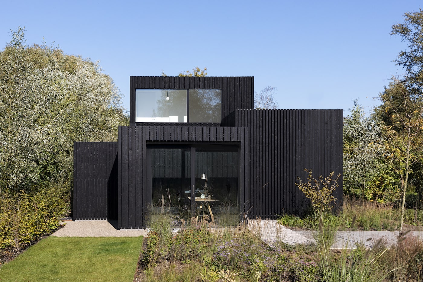 Exterior of black timber clad home