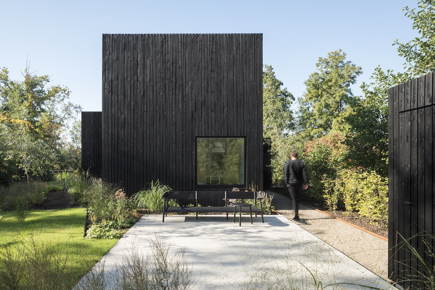 Rear courtyard of black timber clad tiny home