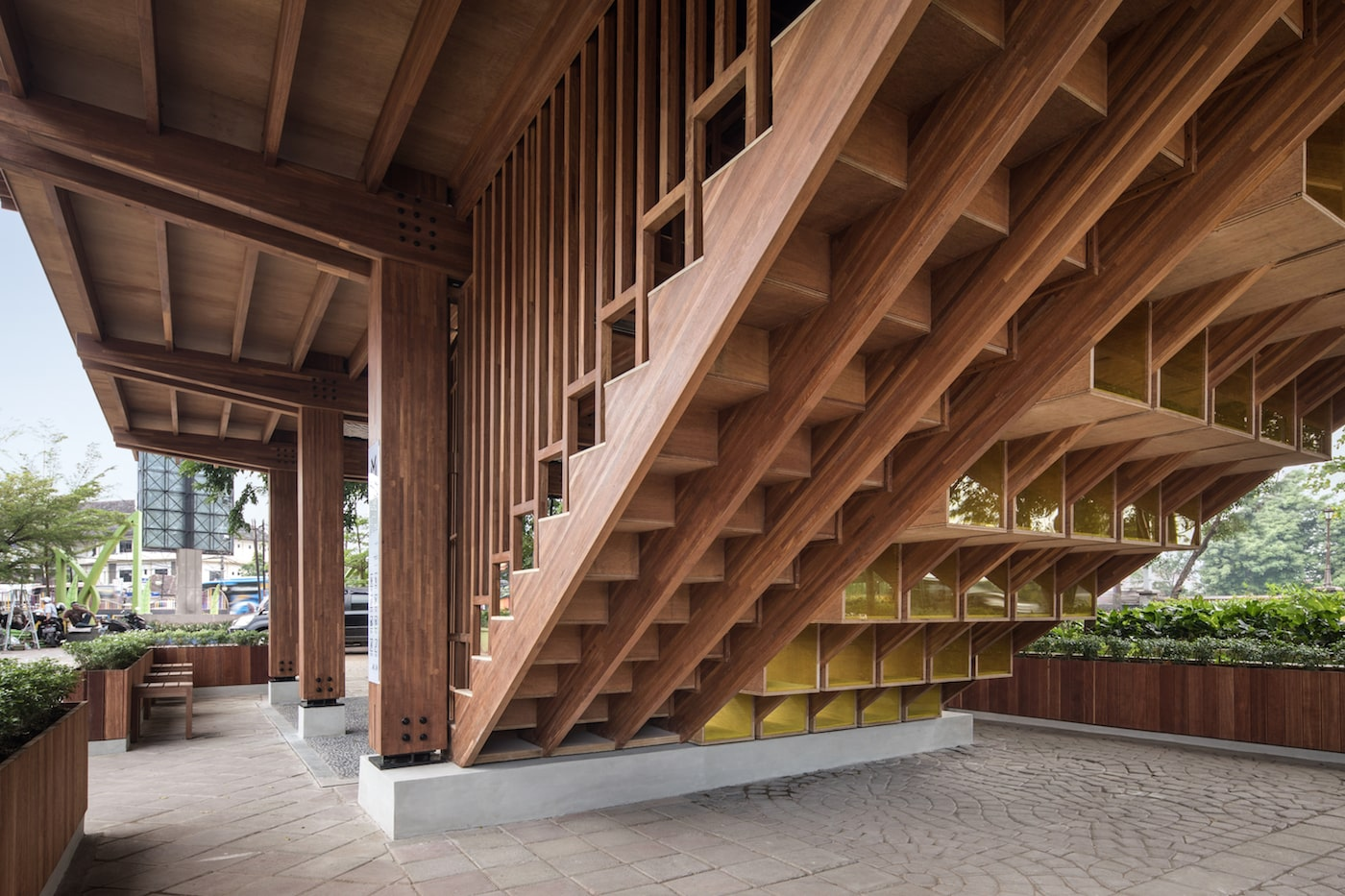 View of under side of timber staircase and timber seating