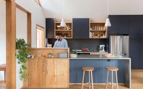 Man at timber kitchen bench
