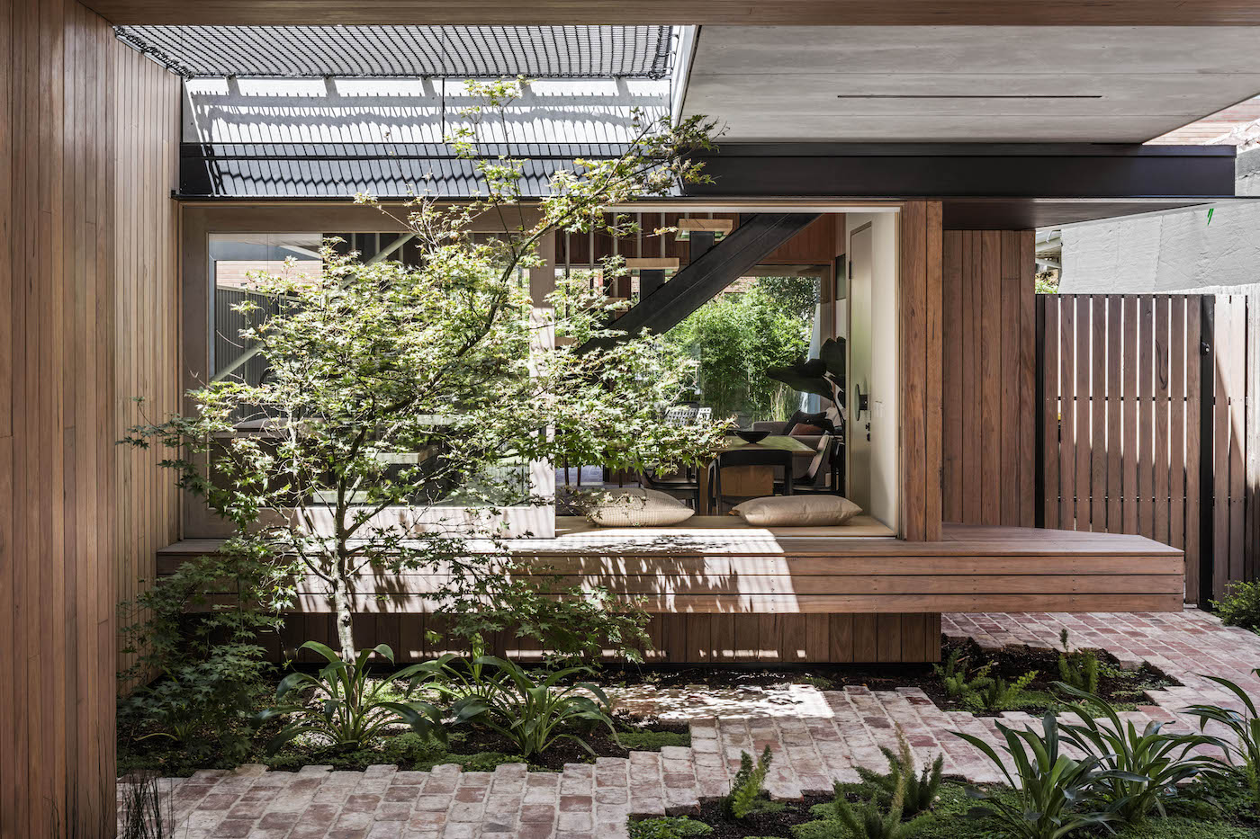 Courtyard with recycled brick pavers and timber walls
