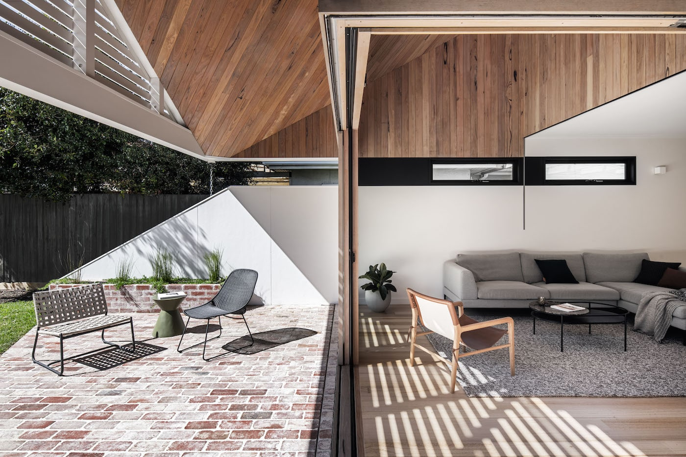 Loungeroom and entertaining area with timber clad ceiling