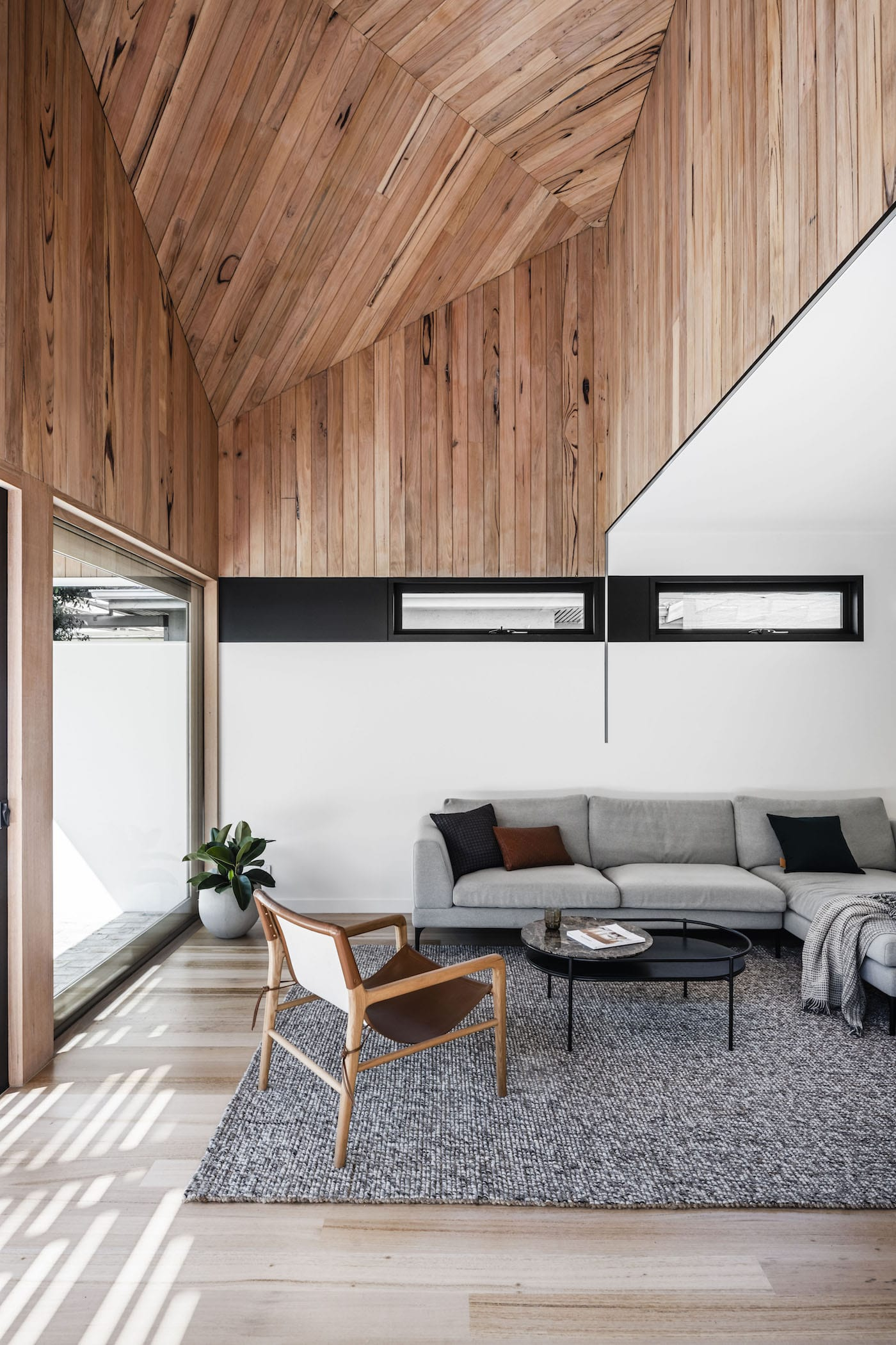Loungeroom with timber clad ceiling