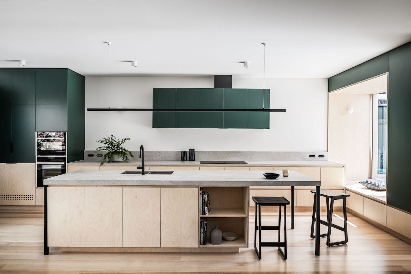Birch plywood kitchen with green cupboards