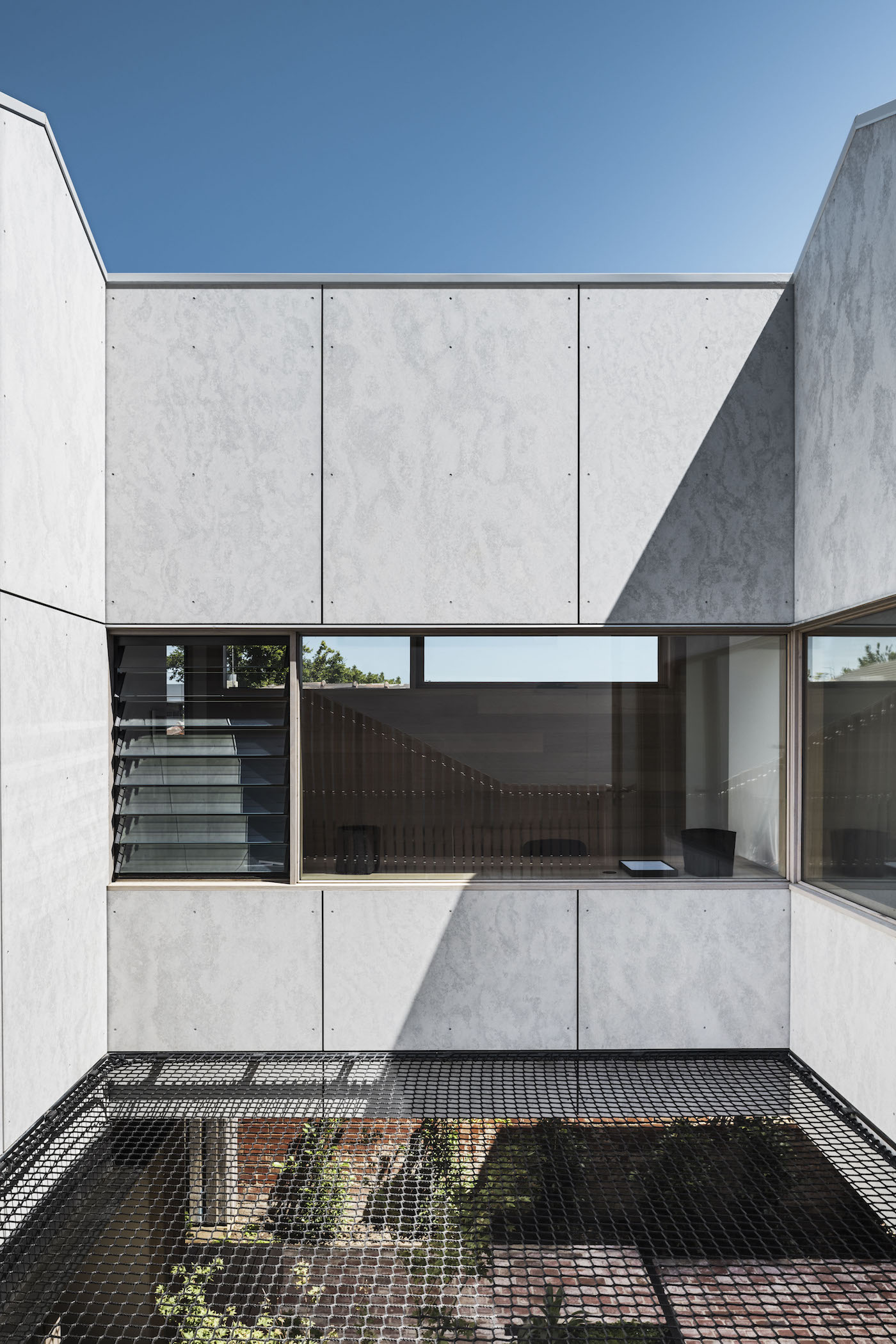 Internal courtyard with suspended netting