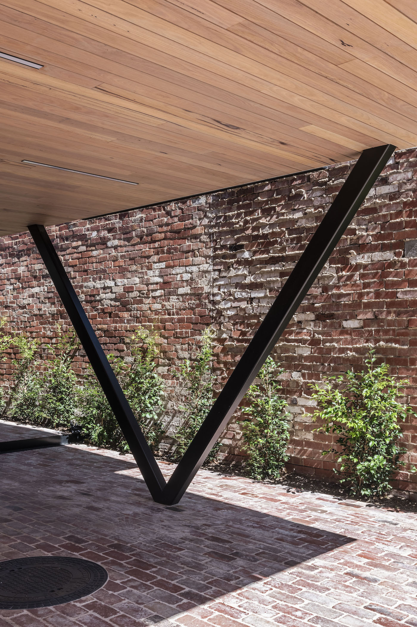 Recycled brick pavers with timber lined courtyard roof