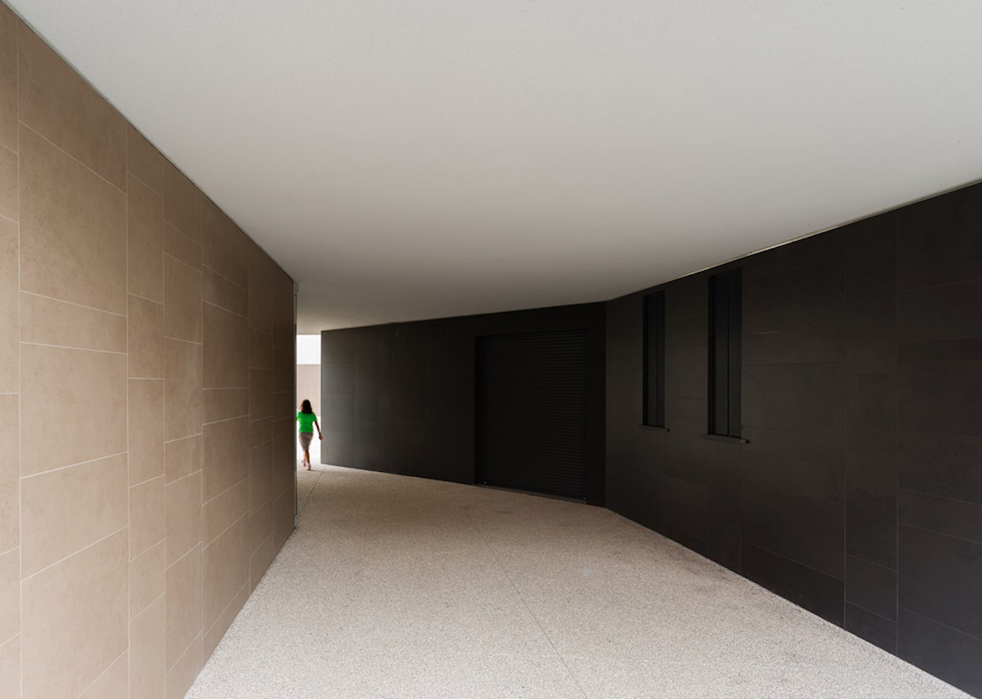 Black curved entry wall